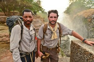 Lev and a local guide in Uganda