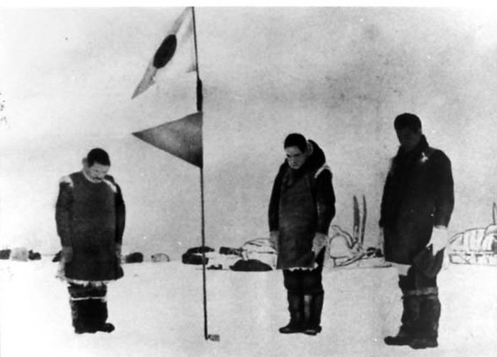 Nobu Shirase raising Japanese flag on Antarctic expedition