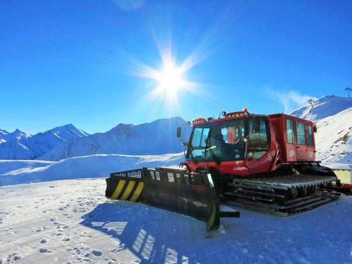 Piste-basher in the Alps