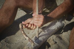 Wood drill fire starting method