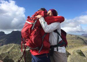 Hikers hugging