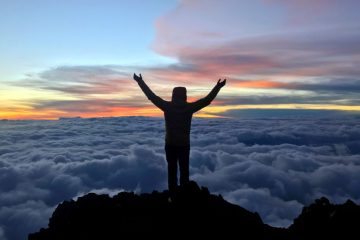 Jon Gupta on the summit of Mount Kilimanjaro