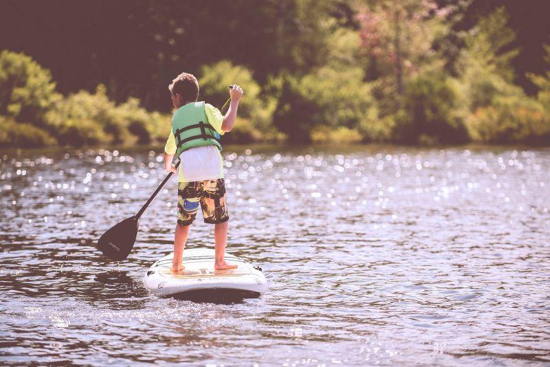 Child paddle boarding