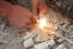 Lighting a fire with a fire steel