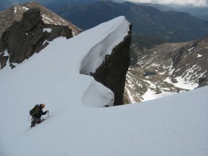 Using an ice axe and crampons