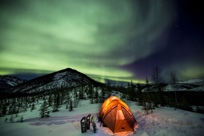 Wild camping under the Northern Lights in Yukon Canada