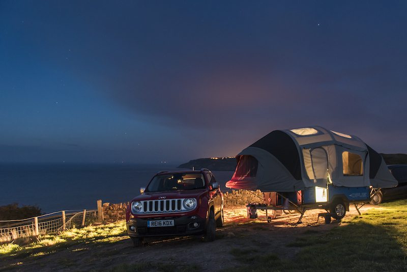 Opus camper at night