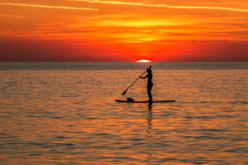 SUP boarding at sunset
