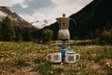 gas camping stoves in the mountains with kettle