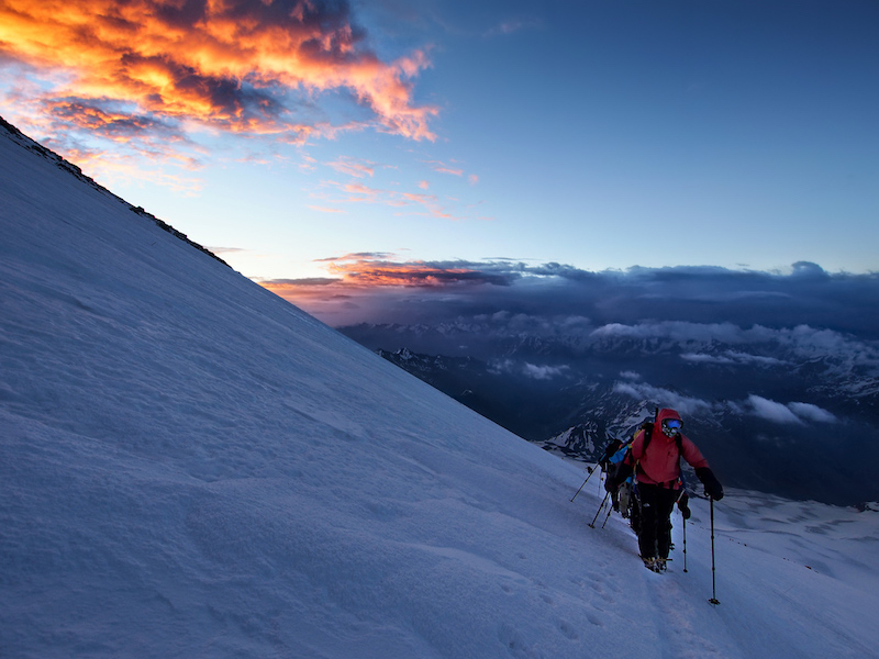 trekking in the sunset on mount elbrus - europe's highest mountain