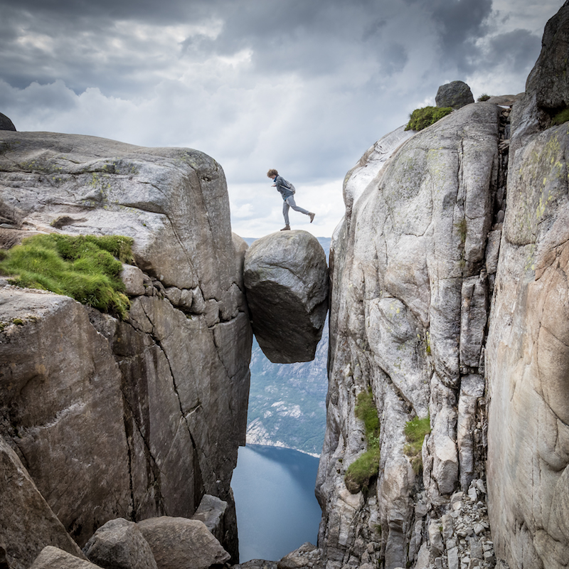 hiker on the kjerag boulder, best hikes in norway