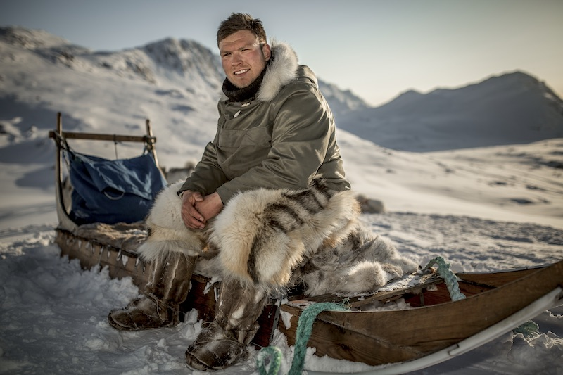 culture greenland travel guide dog sled driver