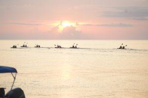 sunset belize sea kayaking event