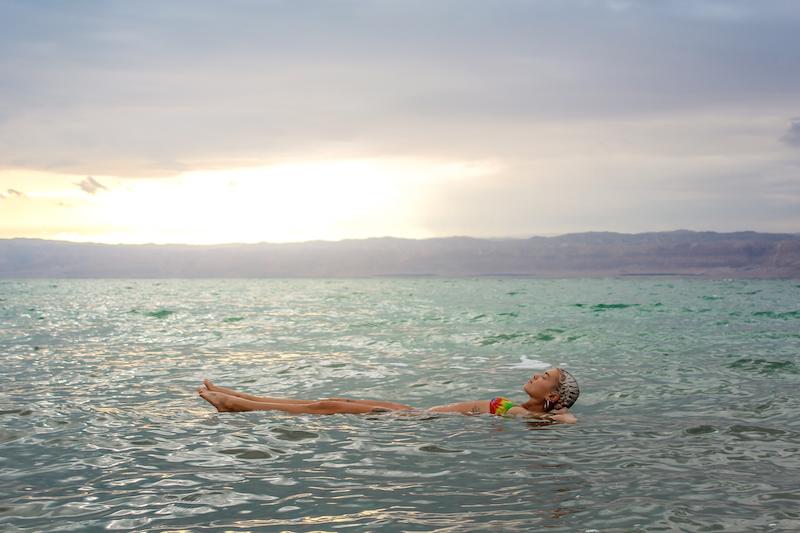 Floating in the Dead Sea, Jordan