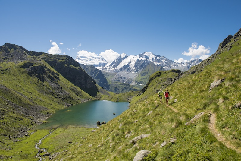 Hikers on the tour of val de bagnes, one of the best hikes in valais, switzerland
