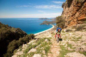 A hiker walking along a coastal path on the lycian way, turkey