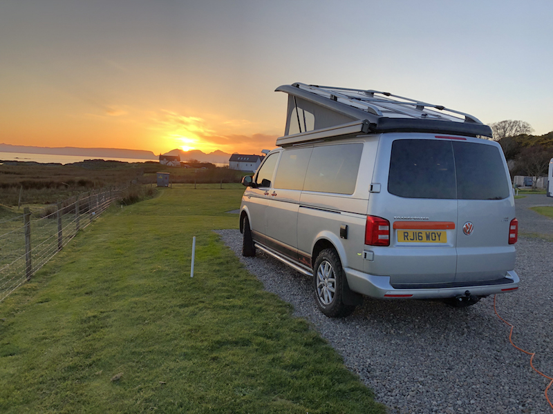 Campervan with a sunset on the west coast of Scotland