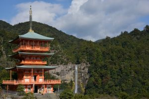 A view of a pagoda and waterfall on the Kumano Kodo Pilgrimage