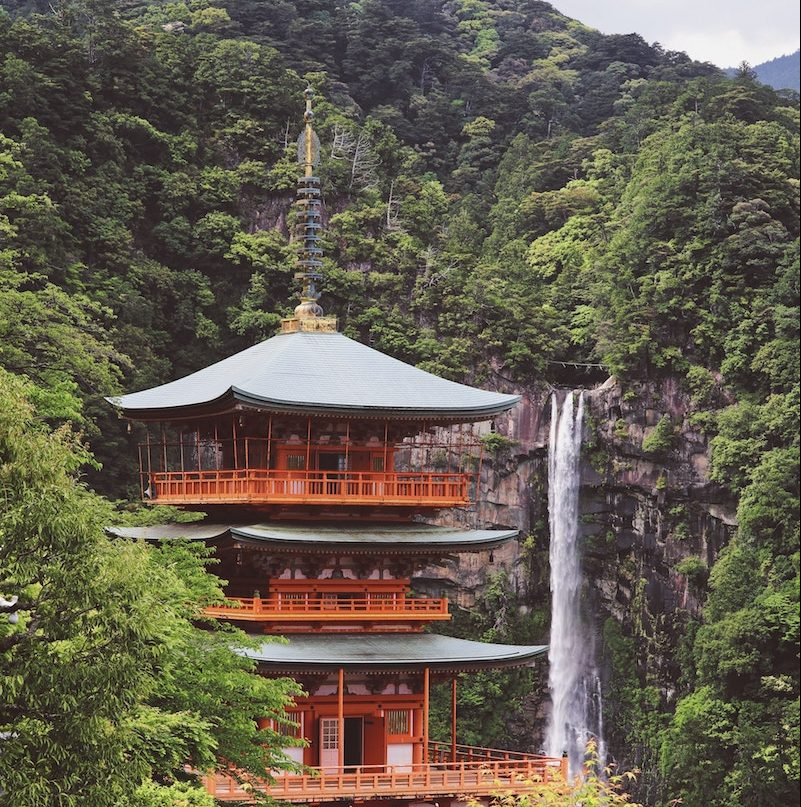 A view of a pagoda and waterfall on the Kumano Kodo Pilgrimage