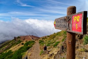 Footpath sign in Madeira above the clouds, one of the best hiking destinations for winter sun