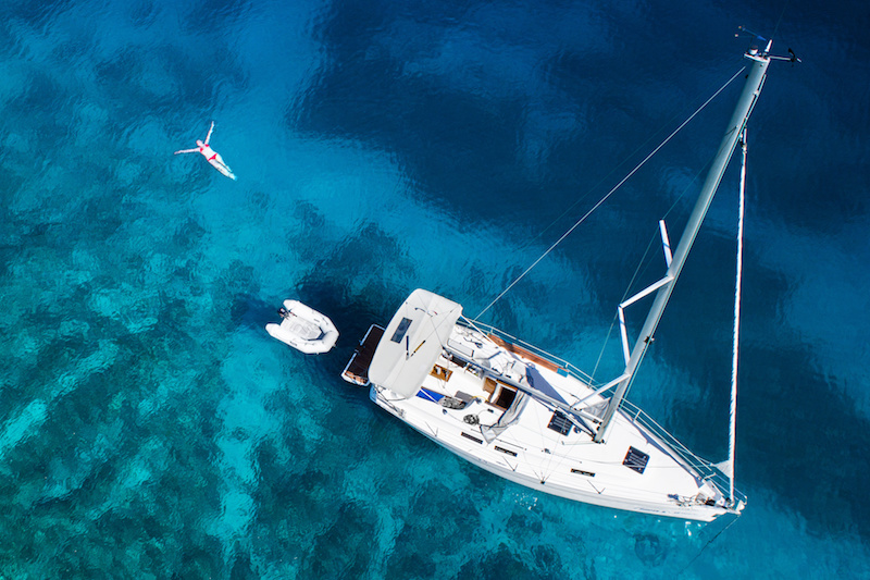 amazing view to yacht, swimming woman and clear water - Mediterranean paradise