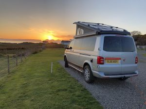 Our camper king van parked up on the west coast of Scotland watching the sunset