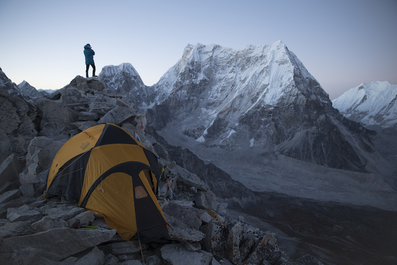 David Lama scouting Lunag Ri from Fox Peak during acclimatization on October 14, 2018