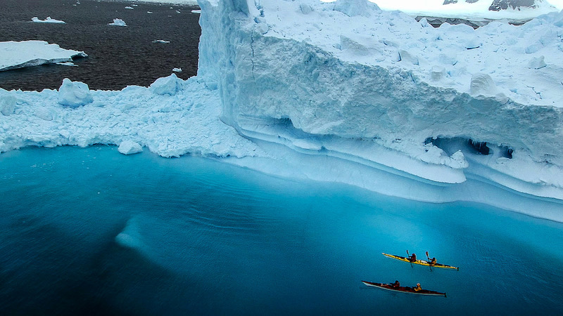 two kayakers in antarctica