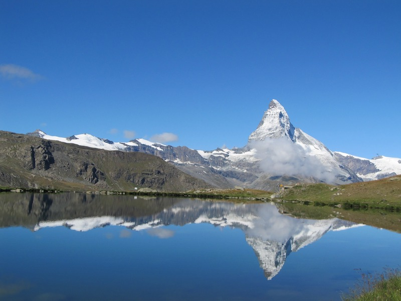 Matterhorn refelcted in a lake on the Zermatt five lakes hike, best hikes in switzerland that are easy to get to