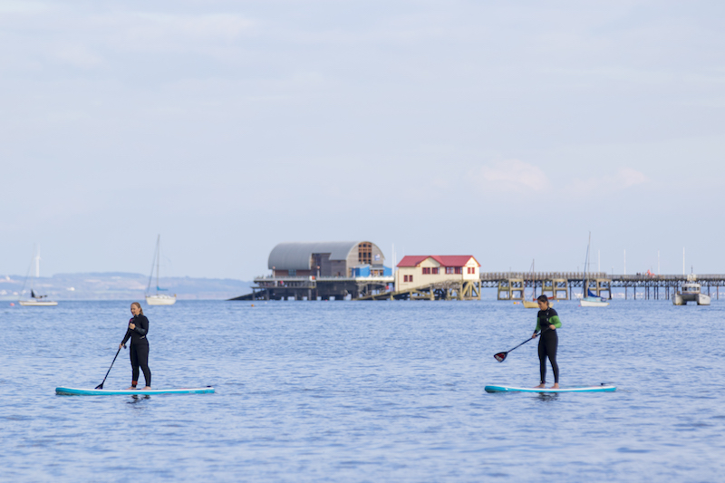 stand-up paddle boarding in Swansea bay best autumn activities in swansea bay