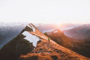 Mountain hiker at sunrise