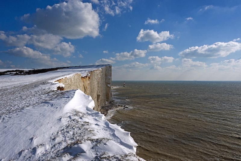 The seven sisters with a blanket of snow, best uk winter coastal hikes