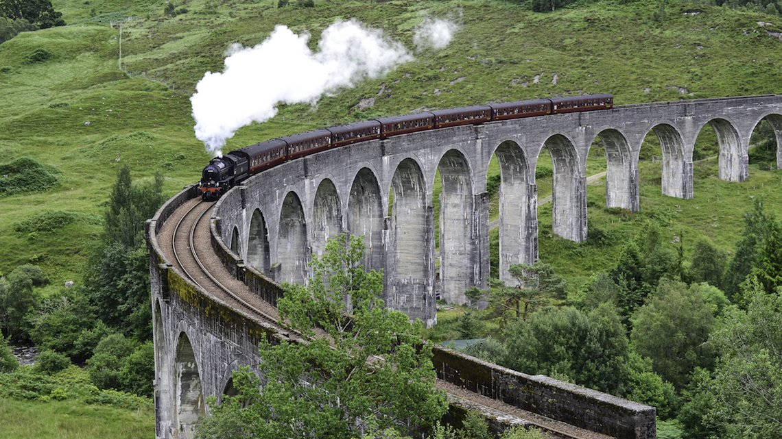 The Jacobite steam train on the Glenfinnan Viaduct, scotland, scenic train journeys