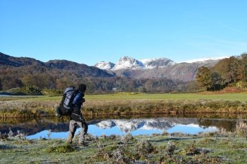 The Langdale Pikes reflected in River Brathay on the Cumbria Way