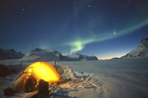 wilderness camping northern lights in east greenland