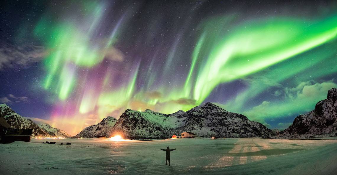 Northern lights man looking up adventure travel show