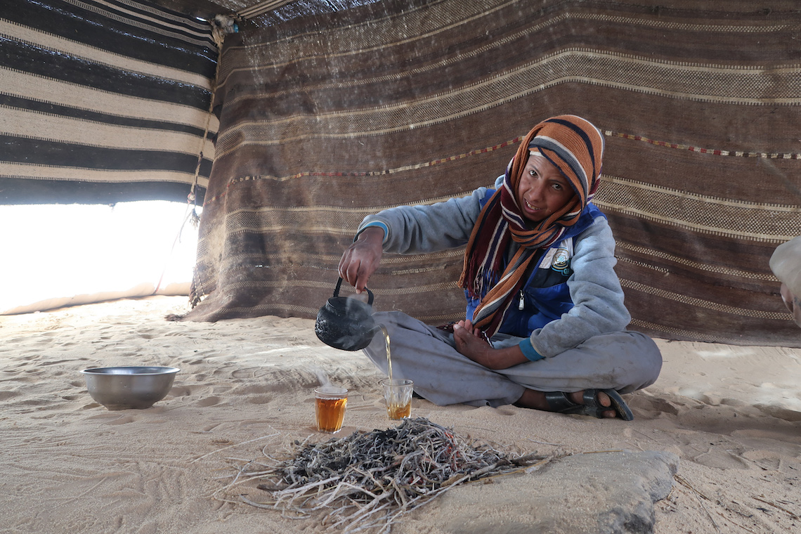 drinking tea in a bedouin tent on the jordan trail