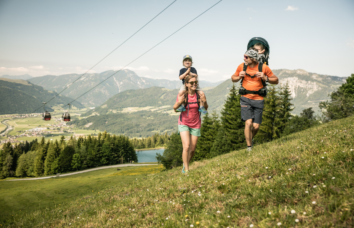 Family hiking up the hillside best things to do in St johann