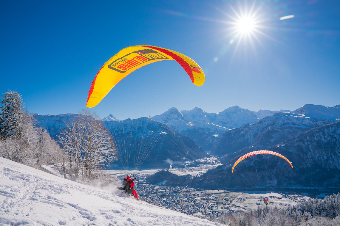Paragliding winter adventure in Switzerland