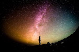 man staring up at the sky best adventures to have at home
